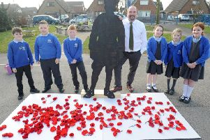 Barnacre Road Primary headteacher Simon Wallis with pupils and some of the many poppies which were knitted for the Longridge schools Armistice Project
