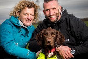 United Utilities Leakage Manager Hannah Wardle, Snipe the dog and his trainer Ross Stephenson