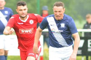 Former PNE skipper Ian Bryson in action against Longridge Town
