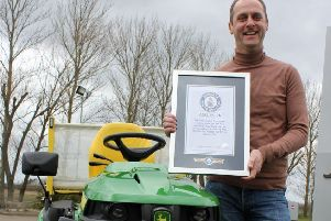 Andy Maxwell shows off his Guinness World Record certificate