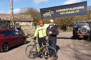 Ian is greeted in Devon after his epic cycle ride by charity founder Mac Mackenney
