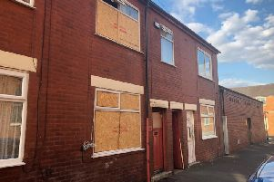 The boarded up house in Maitland Street from which two people were rescued.