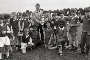 Preston North End striker Alex Bruce with the winning team, St Augustine's (right) and runners-up Holme Slack School (left) after the final of the seven-a-side inter-schools football tournament, which took place at Fulwood Barracks