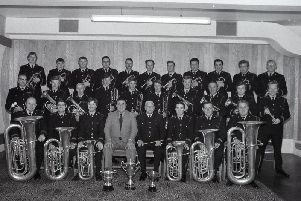 Lancashire Constabulary Brass Band players are blowing their own trumpet - for they have just won 500 and a trophy in a national competition. The band, under the direction of Bandmaster Mr William Hill, beat eight other bands in the Pontins Championship Final Cup contest at the Prestatyn Holiday Village, North Wales