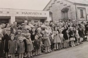 Children line the street near the old Fleetwood Railway Station to welcome Princess Margaret