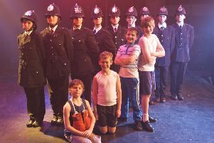 Thomas Atkinson (second from right front row) with fellow members of the cast of Billy Elliot in 2010