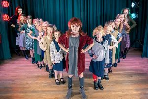 Annie Dawson fronts the cast of orphans in Thornton Cleveleys Operatic Society's production of Annie