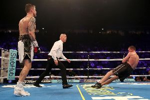 Scotty Cardle hits the deck after the blow by Ricky Burns which ended their Manchester fight