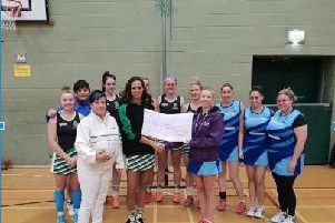 Irene Rawcliffe, chair of Fylde Netball League, and Terri Williams, tournament secretary, present cheques to Claire Upton, Stroke Support Co-ordinator at Stroke Association,and Sarah Green, North West Regional fundraiser for Parkinsons UK.