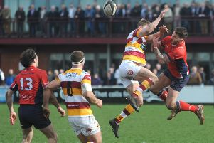Fylde's Tom Grimes goes airborne against Chester