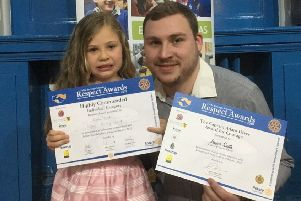 Jessica Smith and dad Kyle with Jessica's awards for saving his life
