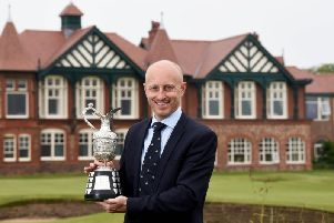Club secretary Charles Grimley with The Senior Open Claret Jug at Royal Lytham and St Annes