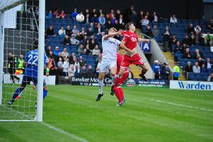 Danny Rowe competes in the air but it wasn't Fylde's night in front of goal Picture: STEVE MCLELLAN
