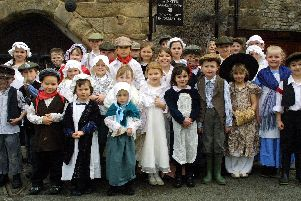2006: Children from Winster Primary School wear their Victorian costumes as the village celebrates 100 years of the National Trust caring for properties in the Peak District.