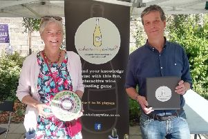 Adam Salt and business partner Vicky Penrice with their what'smywine promotional stand at a sales event in Derbyshire.
