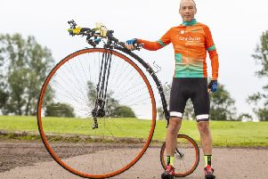Intrepid cyclist Richard Thoday, of Matlock, with the penny-farthing bike that helped him break the record. (PHOTO BY: Katielee Arrowsmith, SWNS)