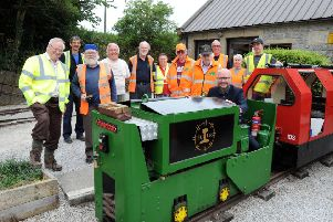 Steeple Grange Light Railway feature. Head of Content, Ashley Booker with the team of volunteers at the Steeple Grange Light Railway in Wirksworth.