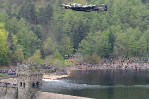 A Lancaster bomber flying over the Derwent Dam.
