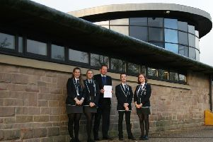 Lady Manners School Sixth Form has received an award from the for the consistently strong progress made by its A-level students over the past three years. Pictured are Sixth Form head Mark Evans and student officers.