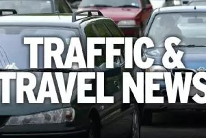 An overturned vehicle has led to the closure of the A6 in Matlock