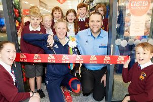 Frances Houghton cuts the ribbon to officially open the new Aldi store in Bakewell.