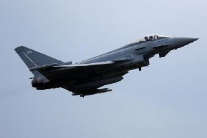 RAF Typhoon, caption PHIL NOBLE/AFP/Getty Images