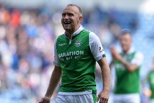 GLASGOW, SCOTLAND - AUGUST 12: Dylan McGeouch of Hibernian smiles at the Hibs fans at the final whistle during the Ladbrokes Scottish Premiership match between Rangers and Hibernian at Ibrox Stadium on August 12, 2017 in Glasgow, Scotland. (Photo by Mark Runnacles/Getty Images)