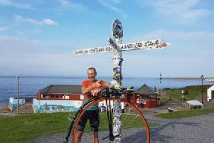 Matlock teaching assistant Richard Thoday has smashed a 133-year-old world record after riding from Land's End to John O'Groats on a penny farthing.