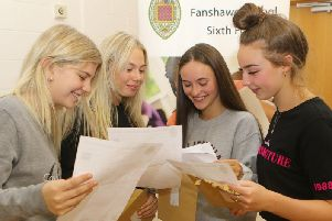 Ella Wilson, Olivia Bourne, Louise Collins and Amelia Siddall compare results at Henry Fanshawe School in Dronfield