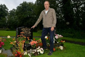 Micheal 'Jim' McCaan at the grave of his wife, Anne, in Darley Dale Cemetery. Photo by Rachel Atkins.