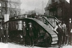 Bonds campaign: Army tanks appeared at various times in Dewsbury during the two world wars. This  WW1 tank was put on public display in Market Place, but not too sure which year it was. Note the Black Bull Hotel on the right.