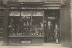 Founded in 1861: An old picture of Archer's shoe shop in Huddersfield Road, Westtown. Not certain who those pictured are, but very likely to be Edward Archer with one of his assistants. The shop was demolished many years after this picture was taken for road widening purposes.