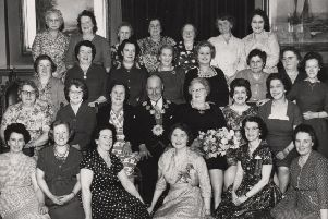Tea party: The late councillor and Mrs Tom Tarney, Mayor and Mayoress of the old County Borough of Dewsbury, are pictured in 1960 in Dewsbury Town Hall, with Mrs Tarney's work colleagues who she invited to a special tea party. Photograph provided by Mr and Mrs Tarney's daughter Catherine.