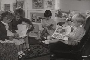 First for Dewsbury: Pictured are children who attended the new purpose-built nursery school built on the Flatts in Dewsbury in 1950. The teacher reading a story to them is Catherine Tarney, who has kindly loaned us this photograph.