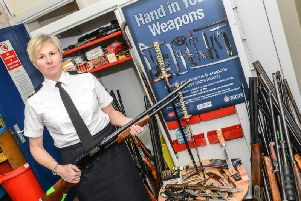 West Yorkshire Police Assistant Chief ConstableCatherine Hankinson with some of the surrendered weapons.