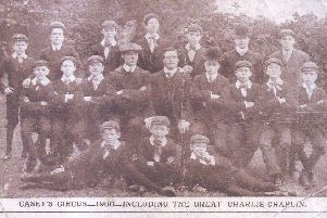 True greats: The young Charlie Chaplin is pictured seated in bowler hat on the middle row when he appeared at the Empire Theatre in 1906 with Casey's Circus. Also pictured, second on the left, on the same row, is a young Stan Laurel, who had strong family connections with Dewsbury. Many of his relatives lived here.