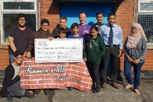 Hospice cash: Kumon Y'All members with the �2,000 cheque for the Forget Me Not Children's Hospice.