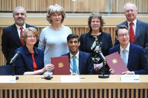 Chancellor Rishi Sunak and Minister Simon Clarke pose with West Yorkshire leaders as the devolution deal is signed. Pic: Danny Lawson PA