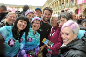 Cyclist Mark Cavendish poses with the Queensbury Queens of the Mountains Cycling Club after a  press conference at The Piece Hall, Halifax. PIC: Tony Johnson