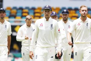 GOING DOWN: England's Joe Root leads his players off the pitch after defeat in the opening Ashes Test match at The Gabba in Brisbane. Picture: Jason O'Brien/PA
