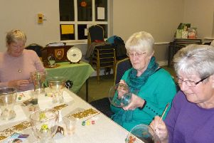 Members of Hepscott WI try their hand at glass painting.