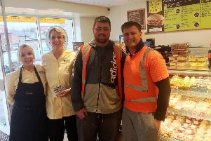 The first customers at the shop pictured with two members of the Morpeth Cooplands team.
