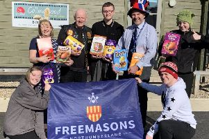 Widows Sons Tom Stewart (second left) with Maureen Spence and headteacher Richard Jones (in hat) with students and the eggs.