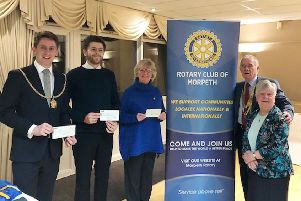 Christmas Tree of Light collection, left to right: Mayor Jack Gebhard, Sanderson Arcade Manager Jack Plumley, Rotary President Bob Kendall and Rotarian Rhona Dunn.