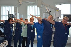 NHS critical care staff demonstrating the 'jab dab'