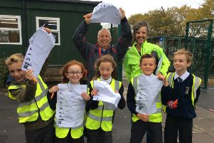 Schools Go Smarter Officers Nigel Bradley and Geoff Crackett with pupils from Star of the Sea Primary School and their travel surveys.