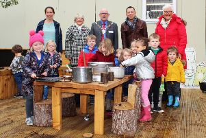 Staff and children from Sir James Knott Nursery School are joined by North Tyneside Council Chairman Coun Tommy Mulvenna (centre) to open the new mud kitchen and potion-making area.