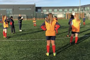 Ex-professional footballer Mike Phelan leads the session at John Spence Community High School.