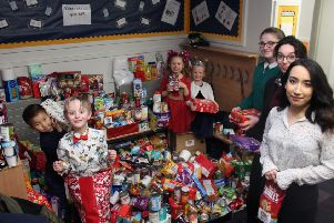 Children and staff at Kings Priory School, in Tynemouth, with some of the donations for BAY Foodbank.