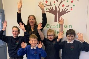 Staff and pupils at Woodlawn School celebrate their latest Ofsted report.
